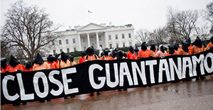 GITMO protesters holding Close Guantanamo sign in front of The White House
