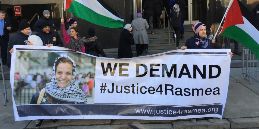"Rally with banner reading ""We Demand Justice for Rasmea"""