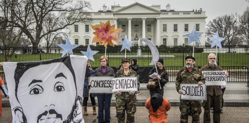 Witness Against Torture protesters in front of White House with image of CCR client Mohammed Al-Hamiri