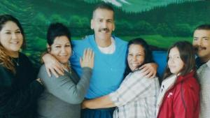 Victor Gallegos with his family. It was their first contact visit in over 20 years.