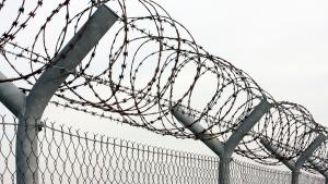 barbed wire on a prison fence