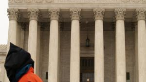 hooded Guantanamo protester in front of Supreme Court