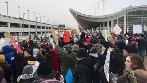 A crowd protests the Muslim ban at a U.S. airport.