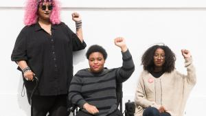 Black queer and trans disabled folks raise fists