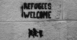 """Refugees Welcome"" spray painted on wall"