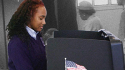 woman of color at a voting booth