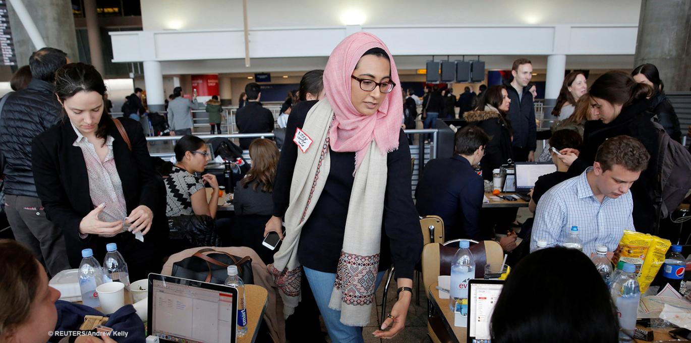 CCR attorney Noor Zafar assists detained travelers at JFK airport