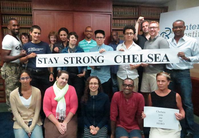 "CCR staff holding a sign that reads ""Stay Strong Chelsea"""