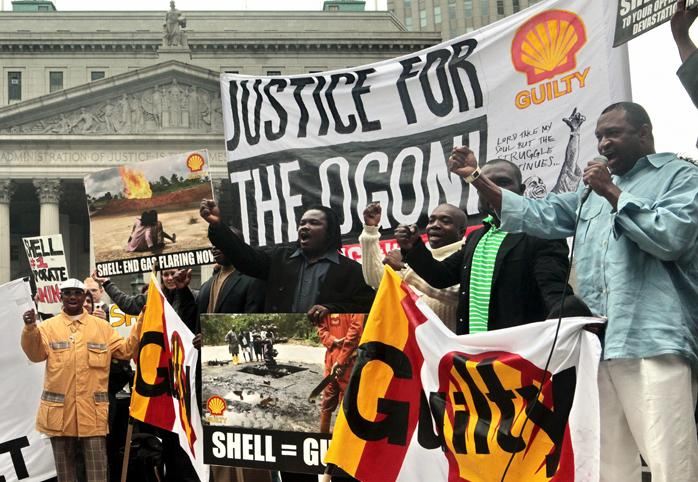 "A protest in front of the U.S. Supreme Court, signs read ""Justice for the Ogoni"""