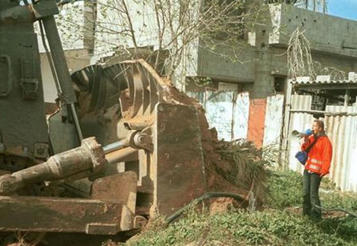 A bulldozer approaches 23-year-old peace activist Rachel Corrie