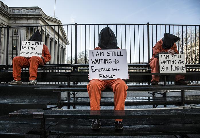 Protesters in prison garb