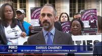 Darius Charney at press conference